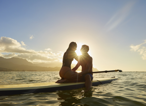 Couple on Paddleboard at Sunset Hawaii