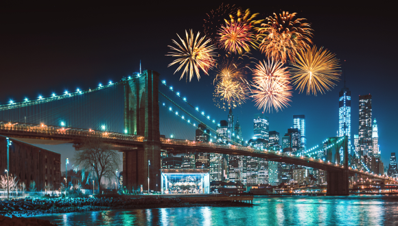 New York City skyline at night with fireworks