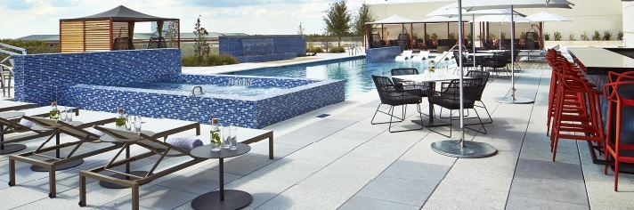 Outdoor pool and patio for recreational, leisure and fitness purposes.