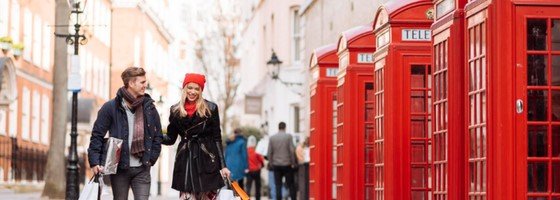 Couple Shopping by Red Phone Boxes London