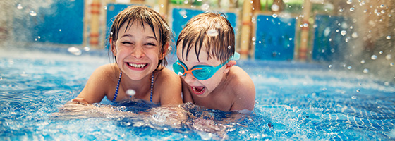 Sister and Brother in Resort Pool